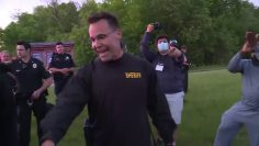 Michigan sheriff takes off helmet and drops baton  Marches with protestors